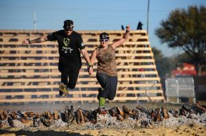 Fire jumping together at the Spartan Race Tampa Spec Ops Sprint